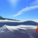 Photographe devant les congères et les volcans